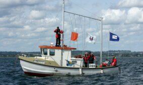 Frivillige til årets to kapsejladsstævner for kølbåde